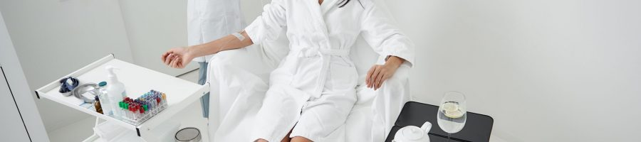 Portrait,Of,Attractive,Woman,In,White,Bathrobe,Lying,With,Closed