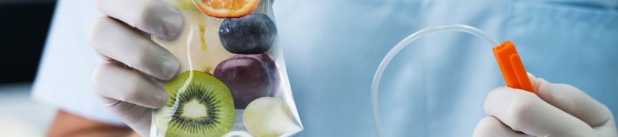 Male,Doctor,Holding,Saline,Bag,With,Fruit,Slices,Inside,In
